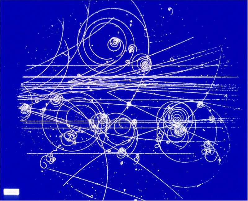 Bubble chamber image of charged particles being deflected by a magnetic field (CERN)