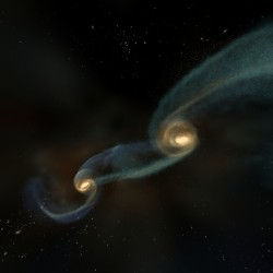 Colliding galaxies can force the supermassive black holes in their cores together (NCSA)