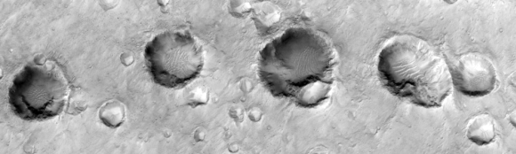 A few irregularly shaped craters from secondary, low energy impacts on the Mars surface (NASA)