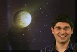 Ignasi Ribas with simulated picture of the new planet.  Image Credit:  REUTERS/Sergio Perez