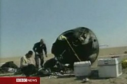 The blackened Soyuz descent capsule after re-entry (BBC)