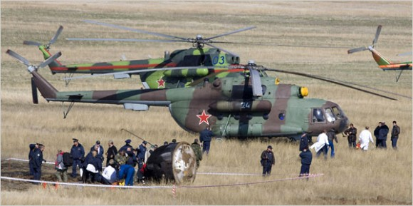 Rescue helicopters next to the askew Soyuz on Saturday (Shamil Zhumatov)