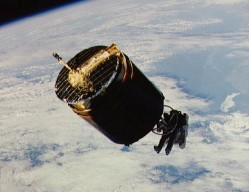 View of the Westar 6 satellite while Dale Gardner retrieves it during STS-51-A in 1984 (NASA)