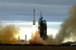 Long March II F rocket carrying Chinas second manned spacecraft Shenzhou VI in 2005 (Xinhua)