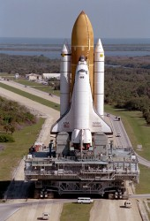 Space Shuttle Discovery inching its way along the Crawlerway to pad 39B (NASA)