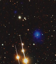 The bright blue blob is an ancient galaxy cluster. Credits: ESA XMM-Newton/EPIC, LBT/LBC, AIP (J. Kohnert)
