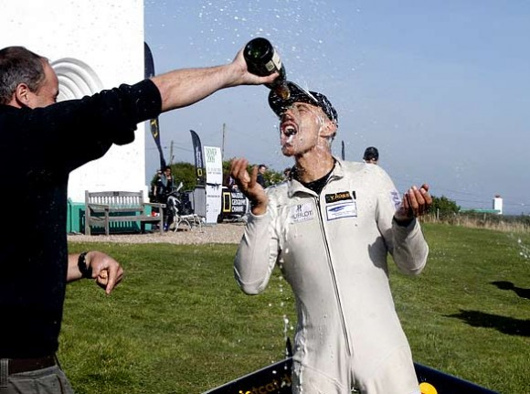 The Swiss pilot Yves Rossy is sprayed with champagne near Dover after flying with jet-propelled wings across the Channel from France  (Adrian Dennis/AFP/Getty)