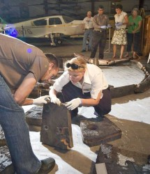 Matt Gasch of NASA Ames and Betsy Pugel of NASA Goddard examine the remains of a 1966 Apollo test vehicle heat shield (Smithsonian Museum/Eric Long)