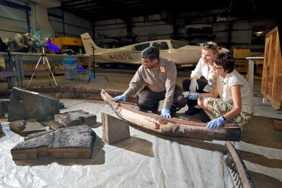 Scientists examine the 1966 Apollo test vehicle heat shield (Smithsonian Museum/Eric Long)