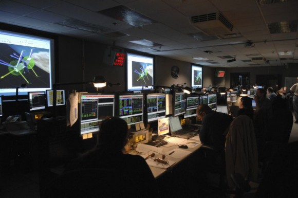 Engineers look on in the Space Telescope Operations Control Center as commands are sent to the SIC and DH.   Credit: NASA