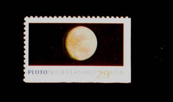 Pluto US postal stamp from 1991.  Credit:  JHU/APL