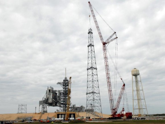 On Launch Pad 39B at NASA's Kennedy Space Center, a crane completes construction of one of the towers in the new lightning protection system for the Constellation Program. Credit: NASA