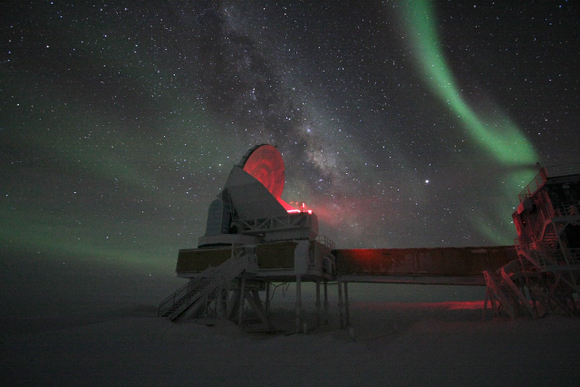 The South Pole Telescope under the aurora australis (southern lights).  Photo by Keith Vanderlinde