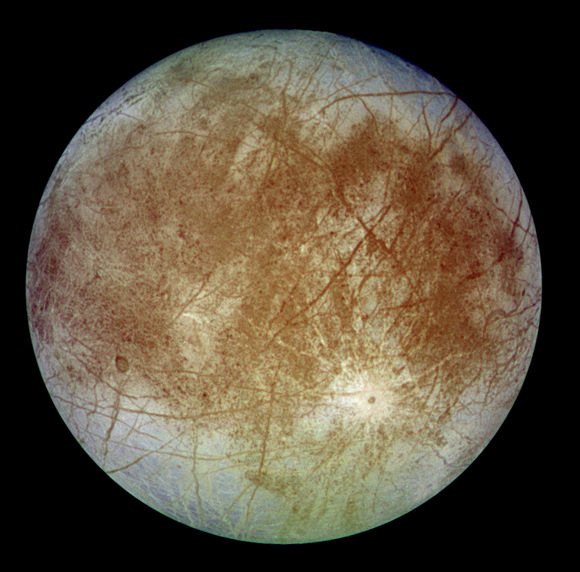 Europa.  CThe cracked, icy surface of Europa. The smoothness of the surface has led many scientists to conclude that oceans exist beneath it. Credit: NASA/JPLredit: NASA
