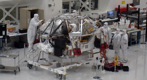 Engineers and scientists for MSL work in JPL's clean room.  Credit: JPL