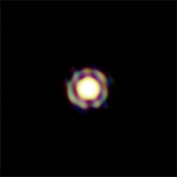 This image from ESOs Very Large Telescope Interferometer is one of the sharpest colour images ever made. It shows the Mira-like star T Leporis in great detail. The central disc is the surface of the star, which is surrounded by a spherical shell of molecular material expelled from the star. In order to appreciate the feat of such measurement, one should realize that the star appears, on the sky, as small as a two-storey house on the Moon. The resolution of the image is about 4 milli-arcseconds.