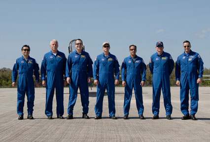 The crew members for the STS-119 mission pose for a photo after arriving at NASA's Kennedy Space Center in Florida to prepare for launch. Photo credit: NASA/Kim Shiflett