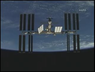 Screenshot of ISS flyaround by shuttle Discovery.  Credit: NASA TV