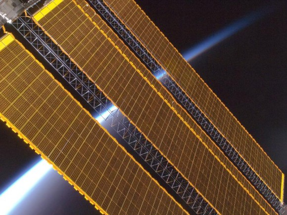 Our Earth's horizon and the International Space Station's solar array panels are featured in this image photographed by the Expedition 17 crew in August 2008.  Credit: NASA