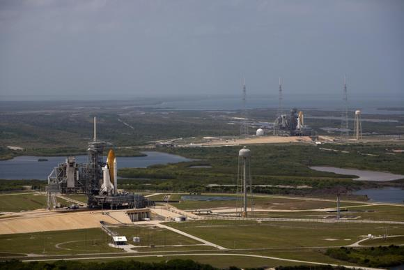 Space shuttle Atlantis (left) and Endeavour stand on Launch Pads 39A and 39B at NASA&#039;s Kennedy Space Center in Florida. This is likely the last time this will happen.  Image Credit: NASA