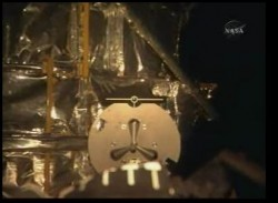 The view from the shuttle&#039;s RMS camera of the grapple fixture on Hubble. NASA TV.