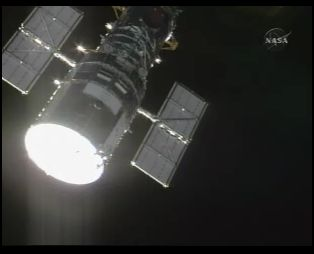 Screenshot of first view of Hubble from Atlantis on NASA TV. 