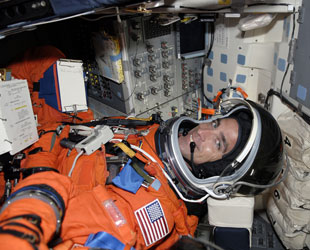 Astronaut Chris Cassidy getting strapped into the shuttle. Credit: NASA