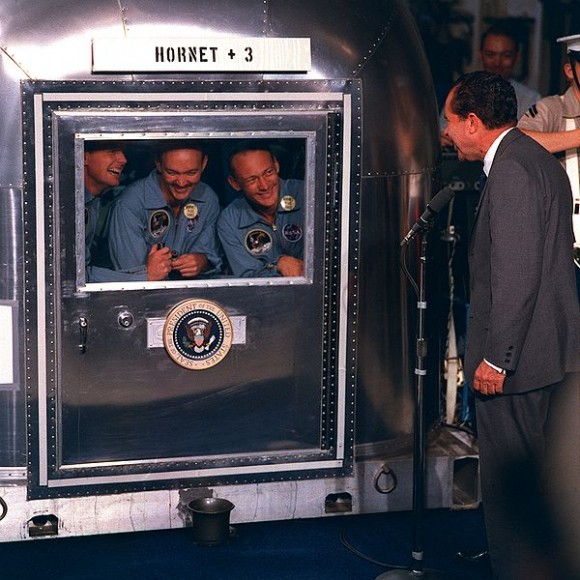 Apollo 11 crew in quarantine talking with President Richard Nixon. Credit: NASA