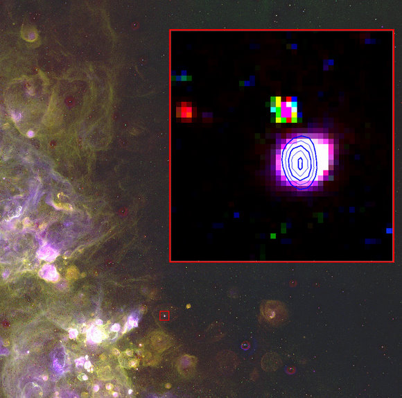 An optical image from the 0.6-m University of Michigan/CTIO Curtis Schmidt telescope of the brightest Radio Planetary Nebula in the Small Magellanic Cloud, JD 04. The inset box shows a portion of this image overlaid with radio contours from the Australia Telescope Compact Array. The planetary nebula is a glowing record of the final death throes of the star. (Optical images are courtesy of the Magellanic Cloud Emission Line Survey (MCELS) team).