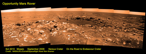 Opportunity mosaic from Sol 2010 showing Nereus Crater and dunes on the Road to Endeavour Crater.  Credit: NASA/JPL/Cornell/Spaceflight Now/Ken Kremer.  Used by permission.  Click image for larger version.