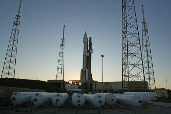 Atlas 5 rocket at sunset surrounded by 4 lightening masts at pad 41. Multiple tanks of compressed gaseous nitrogen at 4800 psi in foreground.   A technical glitch with the ORCA electronics unit critical for flight control forced a scrub for what would have been the 19th flight of an Atlas 5.  Credit: Ken Kremer
