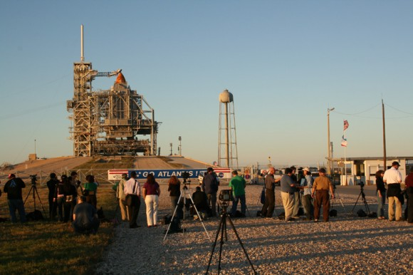 Media from around the globe have descended on the Kennedy Space Center press site to report on STS 129.  I met journalists from many countries including India, Australia, Japan, Korea, Slovenia, Poland, Netherlands, Germany, Turkey, United States and more. RSS rollback has just commenced as we stand at the perimeter security fence surrounding Pad 39 A. Credit: Ken Kremer     