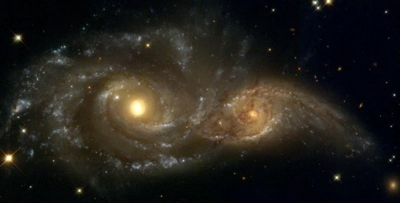 A Grazing Encounter Between Two Spiral Galaxies (NGC 2207 and IC2163).  Credit: HubbleSite