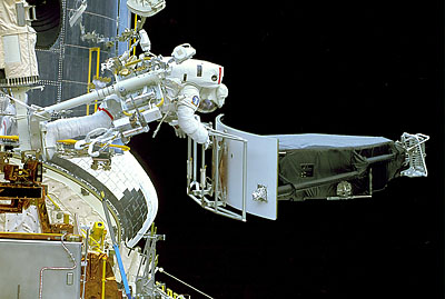 Astronauts replace the Wide Field Planetary camera. Credit: NASA