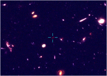 A portion of the Hubble Ultra Deep Field showing the location of a potentially very distant galaxy (marked by crosshairs).   Credit: Oxford University