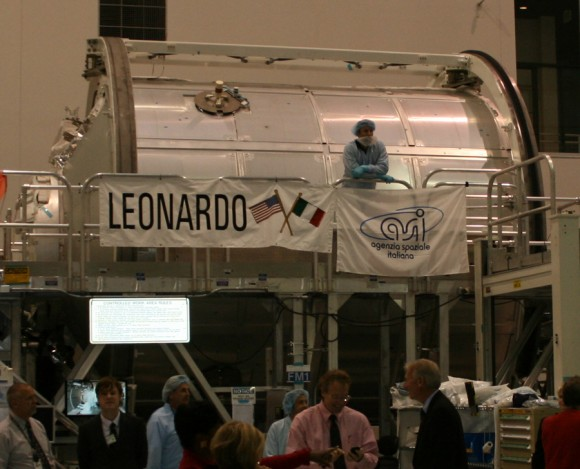 Leonardo MPLM module inside the Space Station Processing Facility at KSC built by Alenia under contract to ESA and the Italian Space Agency (ASI).  This module will be left attached to the ISS on the last scheduled shuttle mission, STS 133. It will be modified with additional shielding for protection against strikes by micrometeoroids. Note grapple fixture at top. Each MPLM is 21 feet long, 15 feet in diameter, weighs 4.5 tons, and can deliver up to 10 tons of cargo to the ISS.  Credit: Ken Kremer