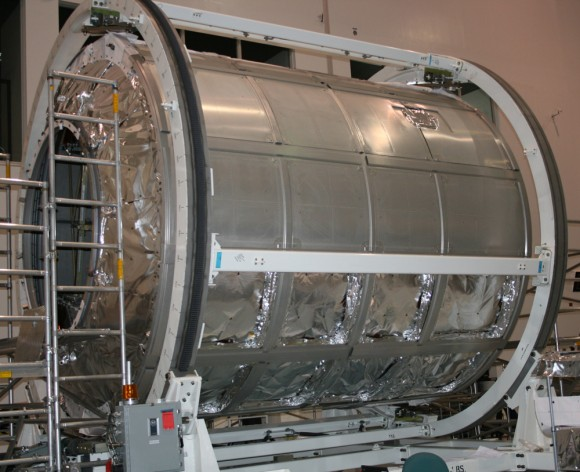 Donatello MPLM module inside the Space Station Processing Facility at KSC.  This module is being utilized for spare parts. Outer shielding is being removed.   Credit: Ken Kremer