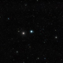 This wide-field image of the sky around the globular cluster Messier 30 was created from photographs forming part of the Digitized Sky Survey 2. Located about 28 000 light-years away from Earth, this cluster -- a swarm of several hundred thousand stars -- is about 90 light-years across. The field of view is approximately 2.9 degrees across.  Credit: ESO and Digitized Sky Survey 2 Acknowledgment: Davide De Martin