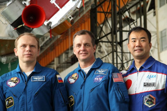 The Expedition 22 crew poses for a group snapshot while visiting the Soyuz launch vehicle assembly facility in front of the rocket's third stage. Crew members are, from the left, Russian cosmonaut Oleg Kotov, Soyuz commander; NASA astronaut T.J. Creamer, flight engineer; and Japan Aerospace Exploration Agency astronaut Soichi Noguchi, flight engineer. Photo credit: NASA/Victor Zelentsov