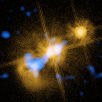 A color composite image of the quasar in HE0450-2958 obtained using the VISIR instrument on the Very Large Telescope and the Hubble Space Telescope. Image Credit: ESO