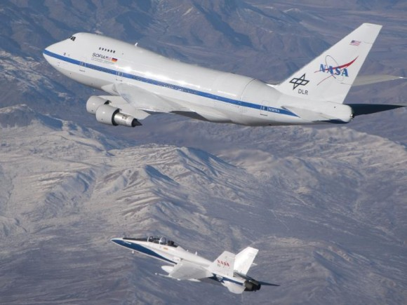 SOFIA, accompanied by an F/A-18 during the open-door testing in December of 2009. Image Credit: NASA/Jim Ross
