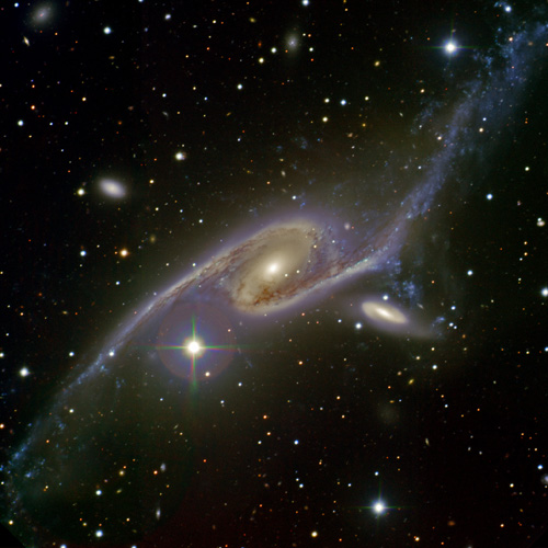 Image of NGC 6872 (left) and companion galaxy IC 4970 (right) locked in a tango as the two galaxies gravitationally interact. The galaxies lie about 200 million light-years away in the direction of the constellation Pavo (the Peacock).  Image credit: Sydney Girls High School Astronomy Club, Travis Rector (University of Alaska, Anchorage), Ángel López-Sánchez (Australian Astronomical Observatory/Macquarie University), and the Australian Gemini Office.