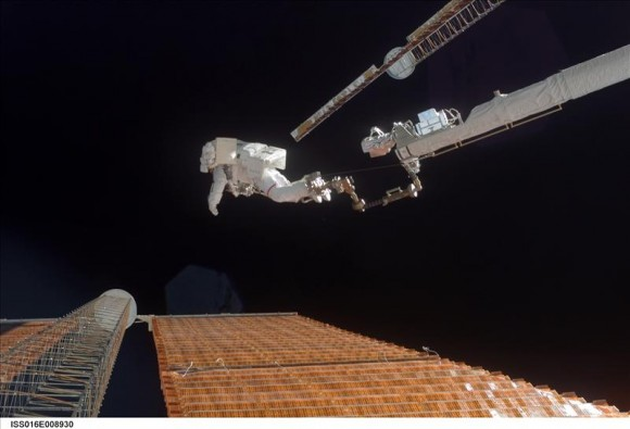 November 3, 2007 – Canadarm2 played a big role in helping astronauts fix a torn solar array.  The arm's reach was extended by the Orbiter Boom Sensor System, and here, allowing astronaut Scott Parazynski analyses the solar panel while anchored to the boom. Credit: NASA