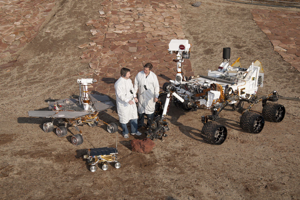 Three generations of mars rovers with standing mars engineers