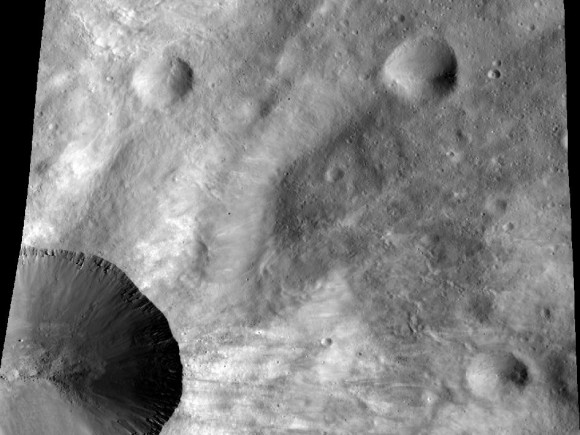 This image from NASA's Dawn spacecraft shows a close up of part of the rim around the crater Canuleia on the giant asteroid Vesta. Canuleia, about 6 miles (10 kilometers) in diameter, is the large crater at the bottom-left of this image. Image credit: NASA/JPL-Caltech/UCLA/MPS/DLR/PSI/Brown