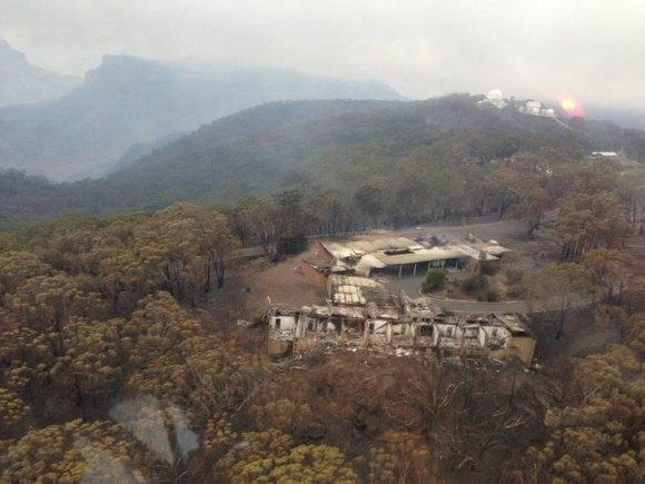 Bush fires destroyed the Lodge where visiting astronomers stayed while working at the Siding Springs Observatory. Photo via the New South Wales Rural Fire Service.