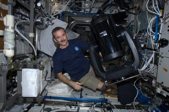 Canadian astronaut Chris Hadfield with the new ISERV (International Space Station SERVIR Environmental Research and Visualization System), a modified Celestron telescope for Earth observation. Credit: NASA/CSA