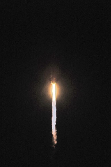 The TDRS-K launch at the beginning of the roll program. Credit: John O&#039;Connor/nasatech.