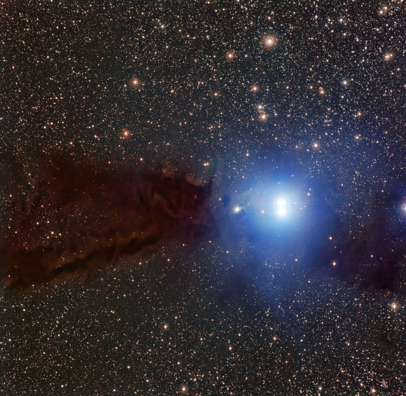 A new image from ESO shows a dark cloud where new stars are forming along with a cluster of brilliant stars that have already emerged from their dusty stellar nursery.  Credit: ESO/F. Comeron.