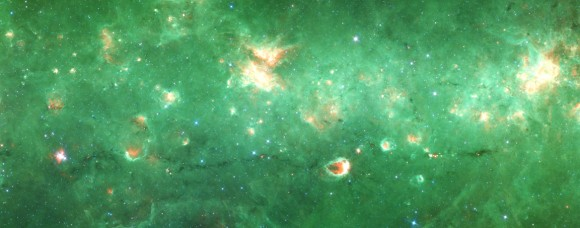 Researchers have identified the first 'bone' of the Milky Way - a long tendril of dust and gas that appears dark in this infrared image from the Spitzer Space Telescope. Running horizontally along this image, the bone is more than 300 light-years long but only 1 or 2 light